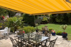 Yellow-Opal-Weinor-Awning-Fitted-in-Ferdown-Dorset-Garden-View-Awningsouth